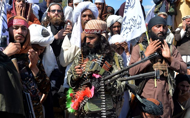 Afghan Taliban militants and villagers attend a gathering as they celebrate the peace deal - Noorullah Shirzada/AFP