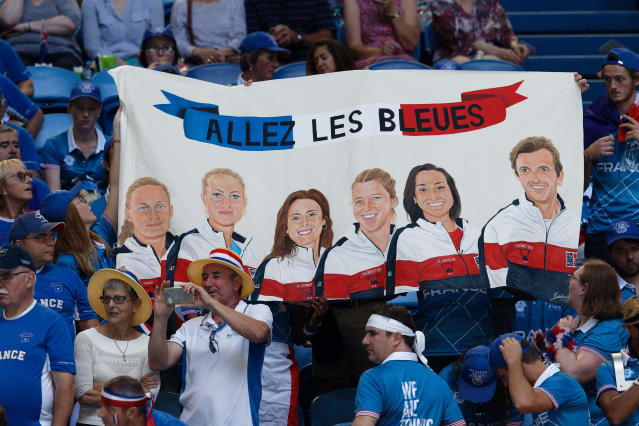 French fans unfurl a banner as they cheer for Kristina Mladenovic during her match against Australia's Ajla Tomljanovic during their Fed Cup tennis final in Perth, Australia, Saturday, Nov. 9, 2019. (AP Photo/Trevor Collens)