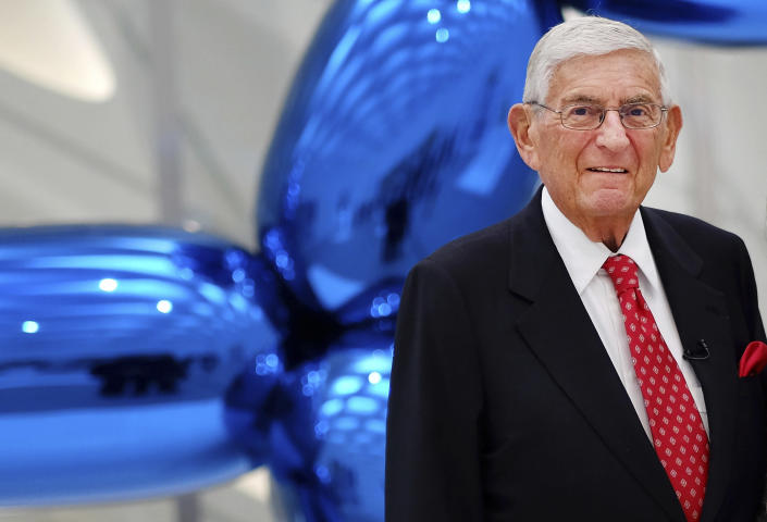 """FILE - In this Sept. 16, 2015 file photo Eli Broad poses for a photo at his museum, """"The Broad"""" in downtown Los Angeles. Eli Broad, the billionaire philanthropist, contemporary art collector and entrepreneur who co-founded homebuilding pioneer Kaufman and Broad Inc. and launched financial services giant SunAmerica Inc., died Friday, April 30, 2021 in Los Angeles. He was 87. (AP Photo/Richard Vogel, File)"""