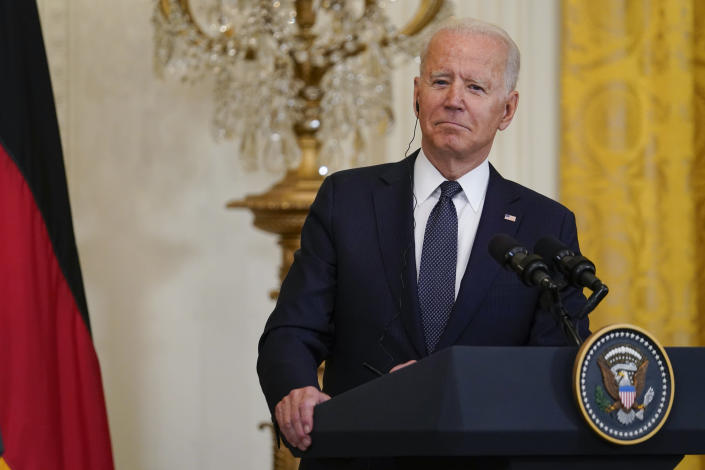 President Joe Biden listens during a news conference with German Chancellor Angela Merkel in the East Room of the White House in Washington, Thursday, July 15, 2021. (AP Photo/Susan Walsh)