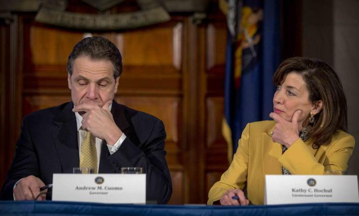 FILE - In this Wednesday, Feb. 25, 2015, file photo, Lt. Gov. Kathy Hochul looks toward New York Gov. Andrew Cuomo during a cabinet meeting at the Capitol in Albany, N.Y. Hochul is preparing to take the reins of power after Cuomo announced Tuesday, Aug. 10, 2021, that he would resign from office amid allegations that he sexually harassed several women. Cuomo denies touching anyone inappropriately. (AP Photo/Mike Groll, File)