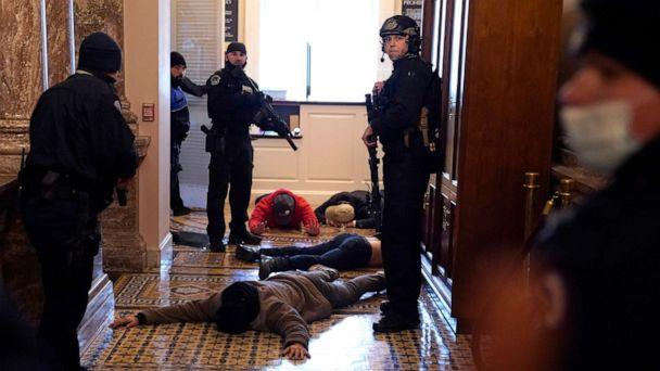 PHOTO: U.S. Capitol Police stand detain protesters outside of the House Chamber during a joint session of Congress on Jan. 6, 2021 in Washington, D.C. (Drew Angerer/Getty Images)