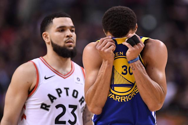 Golden State Warriors guard Stephen Curry (30) reacts in front of the Toronto Raptors' Fred VanVleet during the second half of Game 1 of the NBA Finals. (Frank Gunn/The Canadian Press via AP)
