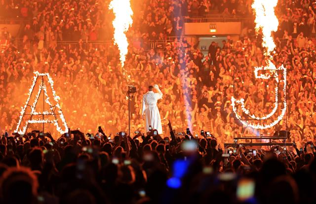 Anthony Joshua makes a spectacular entrance through a crowd of 90,000 fans at Wembley Stadium in London in 2017 to fight Wladimir Klitschko. (Getty Images)