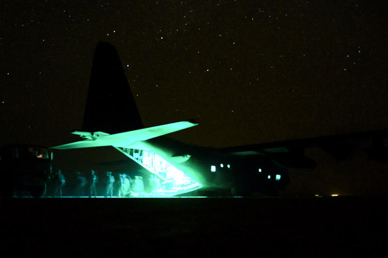 U.S. Soldiers assigned to the 1st Combined Arms Battalion, 63rd Armor Regiment transport cargo from an Air Force MC-130P Combat Shadow aircraft assigned to the 81st Expeditionary Rescue Squadron in the Grand Bara Desert, Djibouti, May 17, 2013, as part of an evaluation exercise in support of Combined Joint Task Force Horn of Africa (CJTF-HOA).