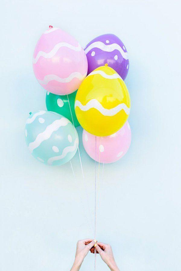"""<p>Bet you'll never look at balloons the same way after making this simple DIY! Craft paint will help you craft a stunning """"Easter egg"""" bouquet.</p><p><strong>Get the tutorial at <a href=""""http://studiodiy.com/2014/04/10/diy-easter-egg-balloons/"""" rel=""""nofollow noopener"""" target=""""_blank"""" data-ylk=""""slk:Studio DIY"""" class=""""link rapid-noclick-resp"""">Studio DIY</a>.</strong></p><p><a class=""""link rapid-noclick-resp"""" href=""""https://www.amazon.com/Latex-Pastel-Balloons-Assorted-10ct/dp/B00D8WL4MK?tag=syn-yahoo-20&ascsubtag=%5Bartid%7C10050.g.1111%5Bsrc%7Cyahoo-us"""" rel=""""nofollow noopener"""" target=""""_blank"""" data-ylk=""""slk:SHOP BALLOONS"""">SHOP BALLOONS</a></p>"""