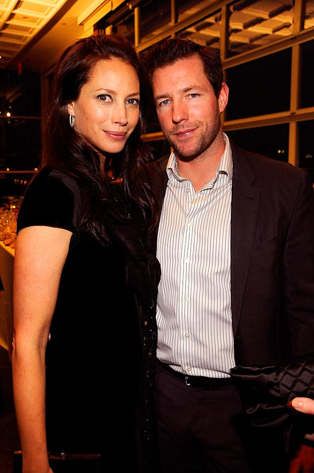 "Christy Turlington and her writer/director husband Ed Burns force smiles when caught canoodling by the event's photographers. Kevin Mazur/<a href=""http://www.wireimage.com"" target=""new"">WireImage.com</a> - April 7, 2008"