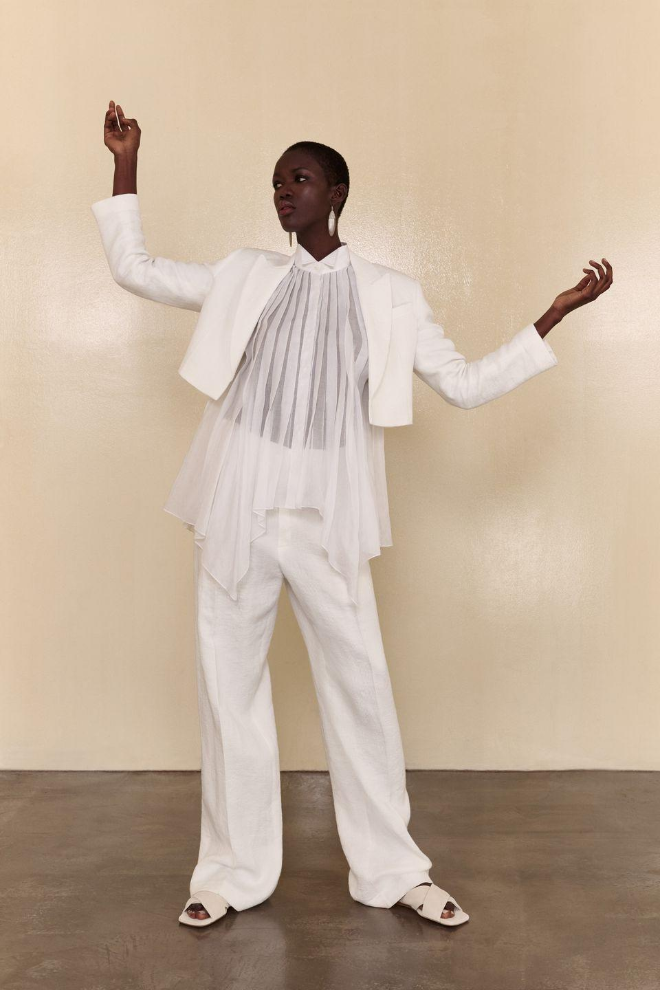 """<p>For many women, the current vibe is """"love thy loungewear as thyself."""" Brunello Cucinelli is cool with that—but he's going to give you a major upgrade. The Italian label went into full slouch mode with his latest collection, which mixes slinky metallic knitwear and silky pleated separates that feel like PJs, but look like you've consulted a famous Italian tailor. (Maybe because one made these clothes...) And though some models did wear sweatbands and tube socks as part of their looks, these pieces are made to be so easily cool, you can get dressed for work without breaking a sweat. Pay special attention to the suiting and square-toed ballet flats, along with a red embroidered varsity sweater that's truly game for anything. —<em>Faran Krentcil</em></p>"""