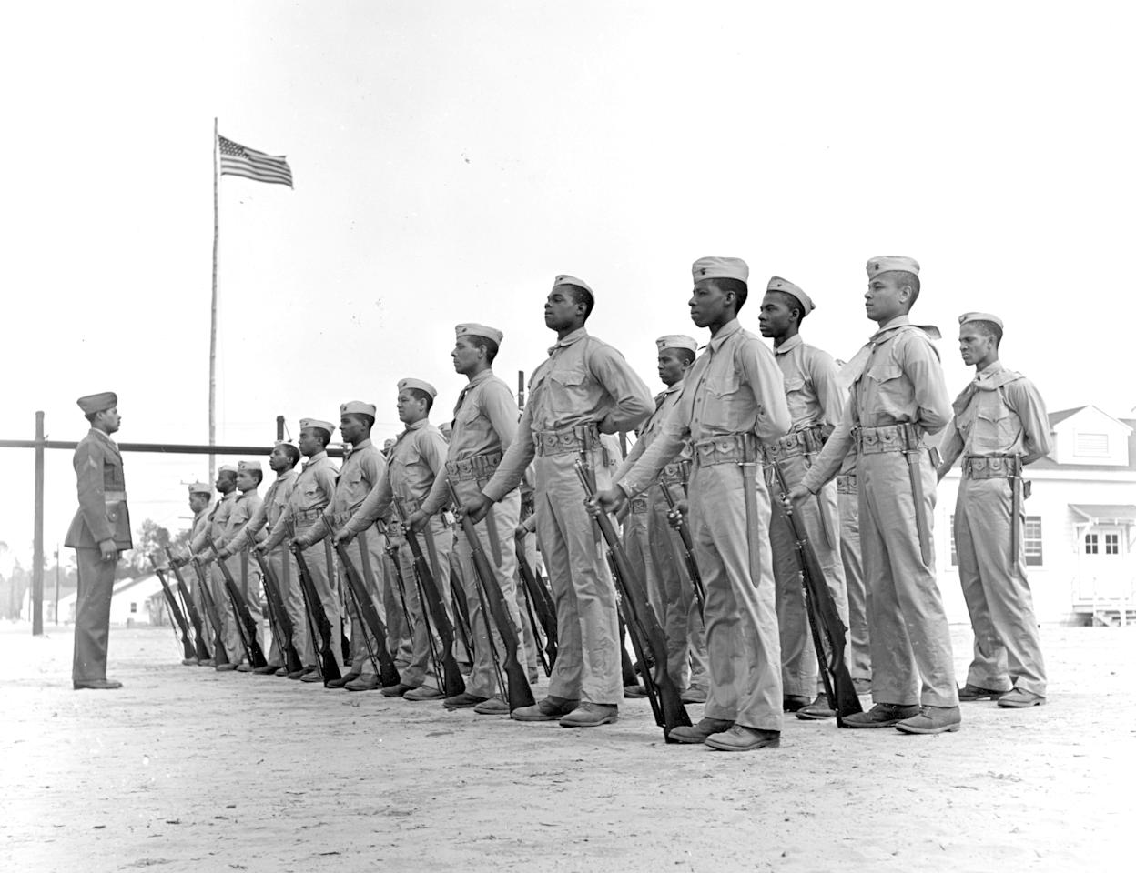 CORRECTS CREDIT TO UNITED STATES MARINE CORPS - In this April 1943 image provided by the Marine Corps, a platoon of Monfort Marine recruits stand at attention in New River, North Carolina. Nearly 70 years after the Marine Corps, the last military branch to racially integrate, accepted segregated black units, the Marine Corps' top general is pushing to honor the history of the Monfort Point Marines. (AP Photo/United States Marine Corps)