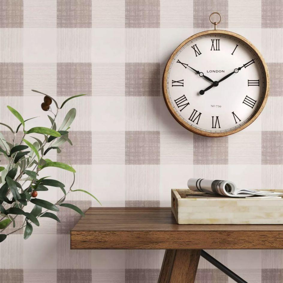 """You can tell time with this wall clock that looks like you found it in a flea market. <a href=""""https://goto.target.com/c/2055067/81938/2092?u=https%3A%2F%2Fwww.target.com%2Fp%2F10-34-thin-pocket-watch-clock-brass-threshold-8482%2F-%2FA-54555682%23lnk%3Dsametab&subid1=5&subid2=cottagecore&subid3=decor"""" target=""""_blank"""" rel=""""noopener noreferrer"""">Find it for $15 at Target</a>."""