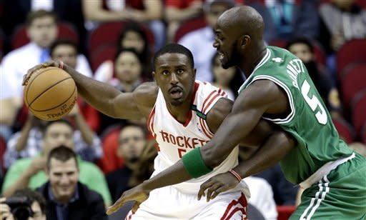 Houston Rockets' Patrick Patterson, left, keeps the ball from Boston Celtics' Kevin Garnett (5) during the first quarter of an NBA basketball game Friday, Dec. 14, 2012, in Houston. (AP Photo/David J. Phillip)