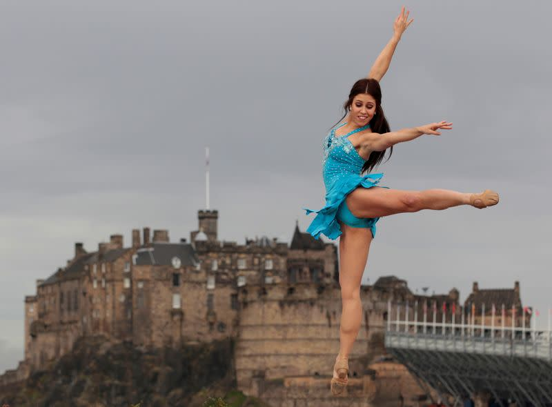 FILE PHOTO: Dancer Lombardi from Rock the Ballet performs with Edinburgh Castle in the background during a photocall for their shows at the Fringe Festival in Edinburgh, Scotland