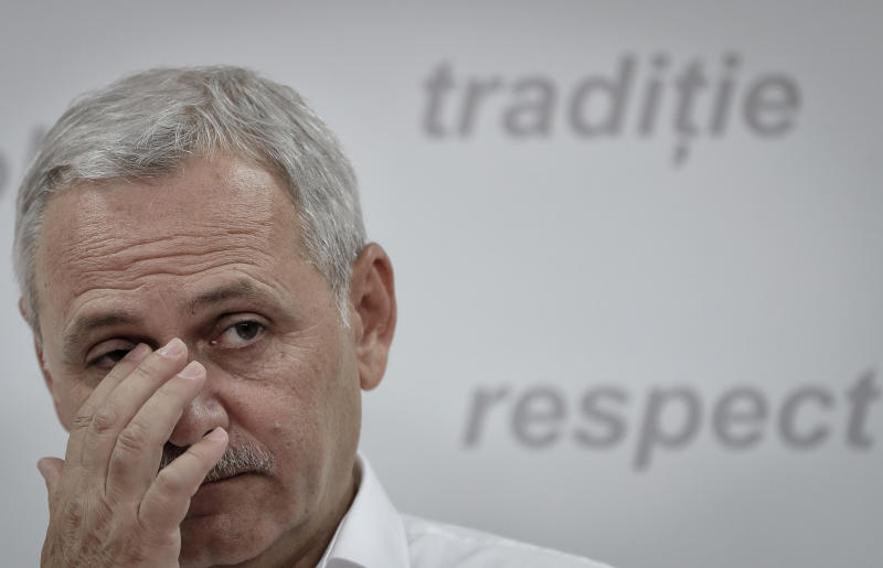Chairman of the Social Democratic Party Liviu Dragnea wipes his eye during a press conference in which he said prime minister Sorin Grindeanu, in office since January, failed to implement the party's governing program, in Bucharest, Romania, Thursday, June 15, 2017. Romania's ruling party voted Thursday to introduce a no-confidence vote against its own government after it withdrew support for Grindeanu but he refused to resign. (AP Photo/Vadim Ghirda)