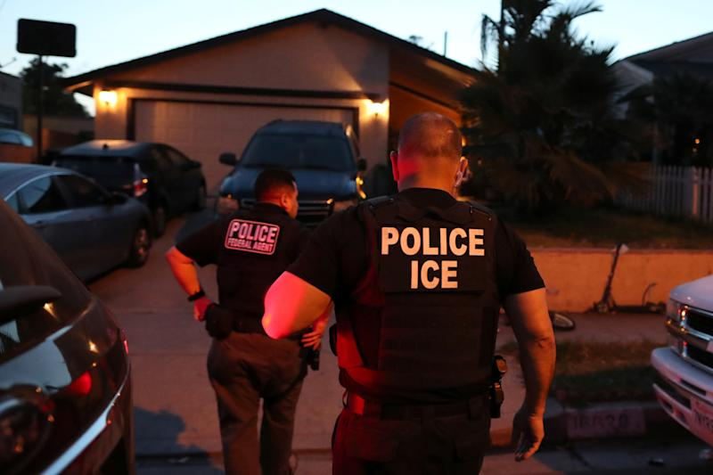 ICE Field Office Director, Enforcement and Removal Operations, David Marin and U.S. Immigration and Customs Enforcement's (ICE) Fugitive Operations team arrive to arrest a Mexican national at a home in Paramount, Calif. on March 1, 2020. (Lucy Nicholson/Reuters)