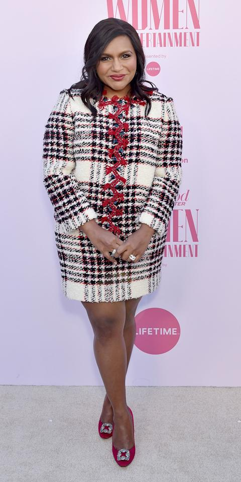 """<p>Mindy Kaling wore an embroidered tweed jacket and mini skirt by <a href=""""https://click.linksynergy.com/deeplink?id=93xLBvPhAeE&mid=1237&murl=https%3A%2F%2Fshop.nordstrom.com%2Fbrands%2Ftory-burch&u1=IS%2CMindyKaling%2Canesta%2C%2CIMA%2C3506462%2C201912%2CI"""" target=""""_blank"""">Tory Burch</a> with coordinating pumps to <em>The Hollywood Reporter's</em> 100 Women in Entertainment event.</p>"""