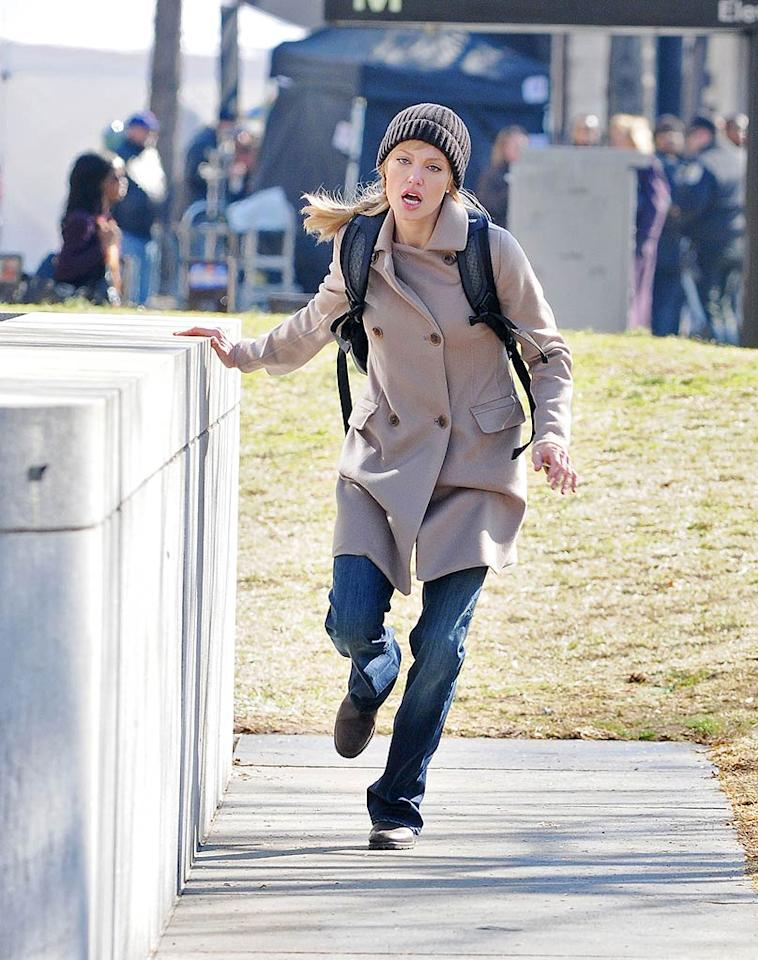 """Brad's significant other Angelina Jolie was also in the nation's capital Thursday. The actress raced through Washington D.C. while filming an action scene for her upcoming thriller """"Salt."""" Ron Asadorian/<a href=""""http://www.splashnewsonline.com"""" target=""""new"""">Splash News</a> - March 5, 2009"""
