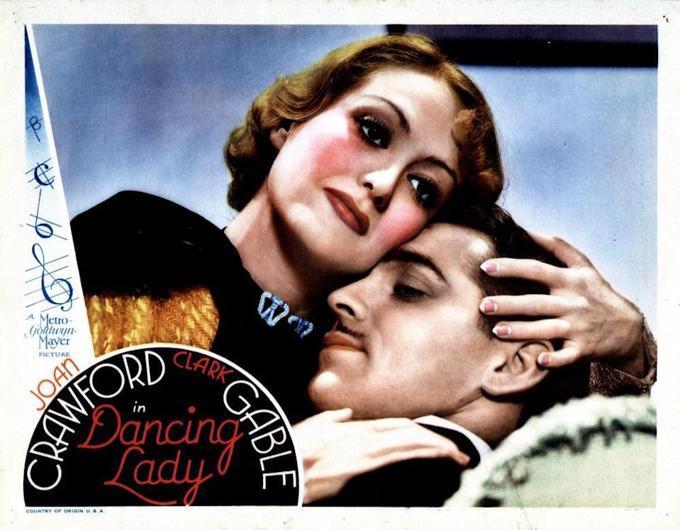 Joan Crawford, half-moon nails on show, with Clark Gable, in 1933's Dancing Lady