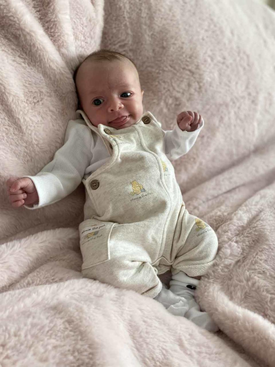 Willow Grace in a Winnie the Pooh onesie. PA REAL LIFE