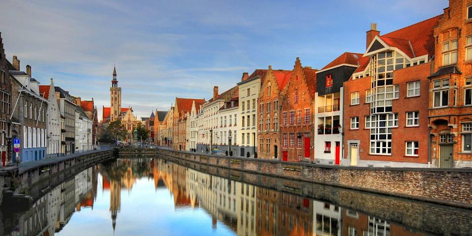 """<p>The Belgium city of Bruges has cobbled streets and charming canals where you can take a <a href=""""https://www.tripadvisor.com/Attraction_Review-g188671-d1205887-Reviews-Canal_Boat_Tours-Bruges_West_Flanders_Province.html"""" rel=""""nofollow noopener"""" target=""""_blank"""" data-ylk=""""slk:scenic tour"""" class=""""link rapid-noclick-resp"""">scenic tour</a> to see its historic churches and half-timbered buildings. Afterward, lunch on <em>moules frites </em>at a café in 13th-century <a href=""""https://www.tripadvisor.com/Attraction_Review-g188671-d265239-Reviews-The_Markt-Bruges_West_Flanders_Province.html"""" rel=""""nofollow noopener"""" target=""""_blank"""" data-ylk=""""slk:Market Square"""" class=""""link rapid-noclick-resp"""">Market Square</a>, then stop into one of Bruges' many chocolate shops for dessert. </p>"""
