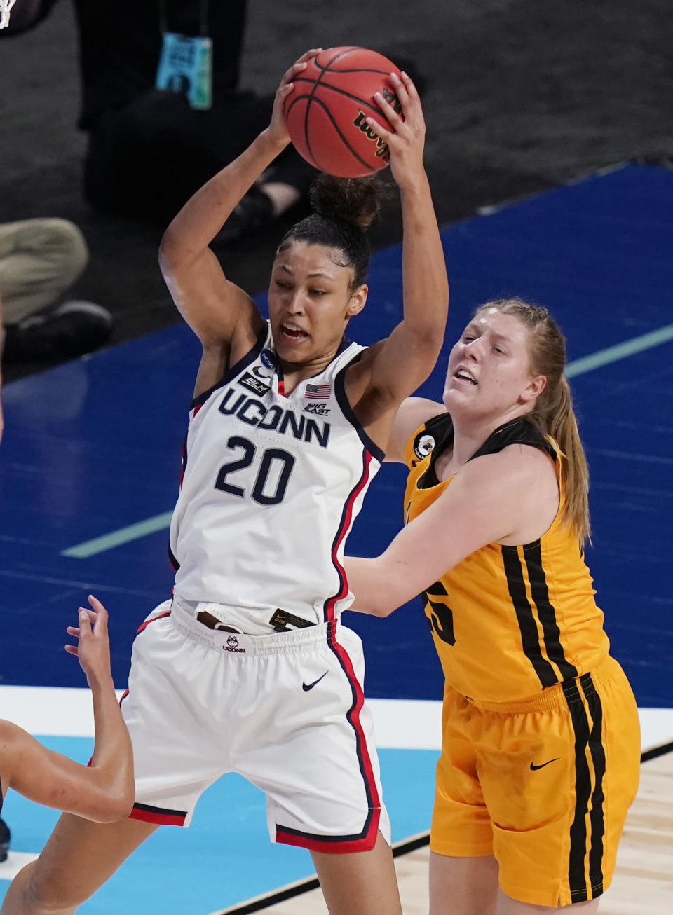 UConn forward Olivia Nelson-Ododa (20) pulls down a rebound over Iowa forward Monika Czinano (25) during the first half of a college basketball game in the Sweet Sixteen round of the women's NCAA tournament at the Alamodome in San Antonio, Saturday, March 27, 2021. (AP Photo/Eric Gay)