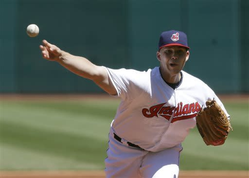 Cleveland Indians starting pitcher Justin Masterson delivers a pitch in the first inning in the first baseball game of a doubleheader against the New York Yankees, Monday, May 13, 2013, in Cleveland. (AP Photo/Tony Dejak)