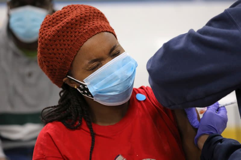 Health workers from Humber River Hospital hold a vaccination clinic in Toronto