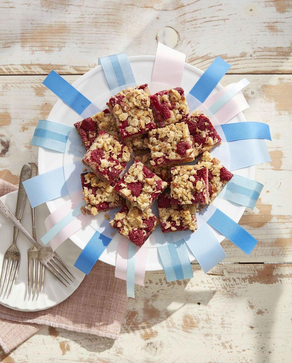 """<p>These buttery, slightly tart dessert bars, displayed on an ironstone cake stand, embellished with ribbon (try red, white, and blue) are the perfect end-of-the-party treat.</p><p><a href=""""https://www.countryliving.com/food-drinks/a32042710/raspberry-crumb-bars/"""" rel=""""nofollow noopener"""" target=""""_blank"""" data-ylk=""""slk:Get the recipe"""" class=""""link rapid-noclick-resp""""><strong>Get the recipe</strong></a><strong>. </strong> </p>"""