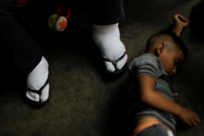 Elimenes Fuenmayor, 65, a patient with kidney disease, waits for the electricity to return, as his grandson lies beside him on the floor in his house during a blackout in Maracaibo, Venezuela. (Photo: Ueslei Marcelino/Reuters)