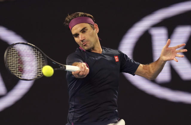 Switzerland's Roger Federer makes a forehand return to Australia's John Millman during their third round match at the Australian Open tennis championship in Melbourne, Australia, Friday, Jan. 24, 2020. (AP Photo/Lee Jin-man)