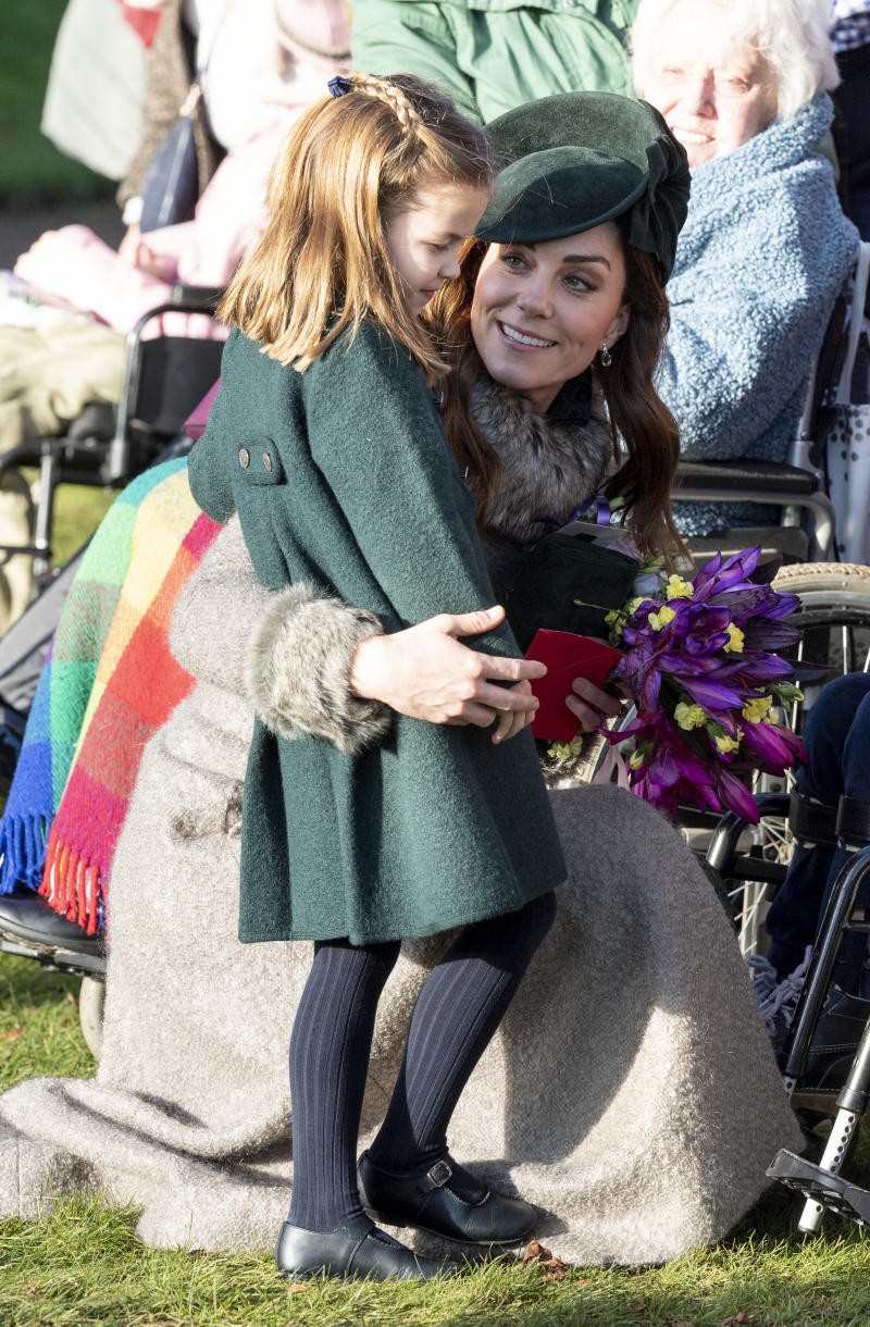 Princess Charlotte of Cambridge and Catherine, Duchess of Cambridge greet well-wishers after the Christmas Day Church service at Church of St Mary Magdalene on the Sandringham estate on December 25, 2019 in King's Lynn, United Kingdom.