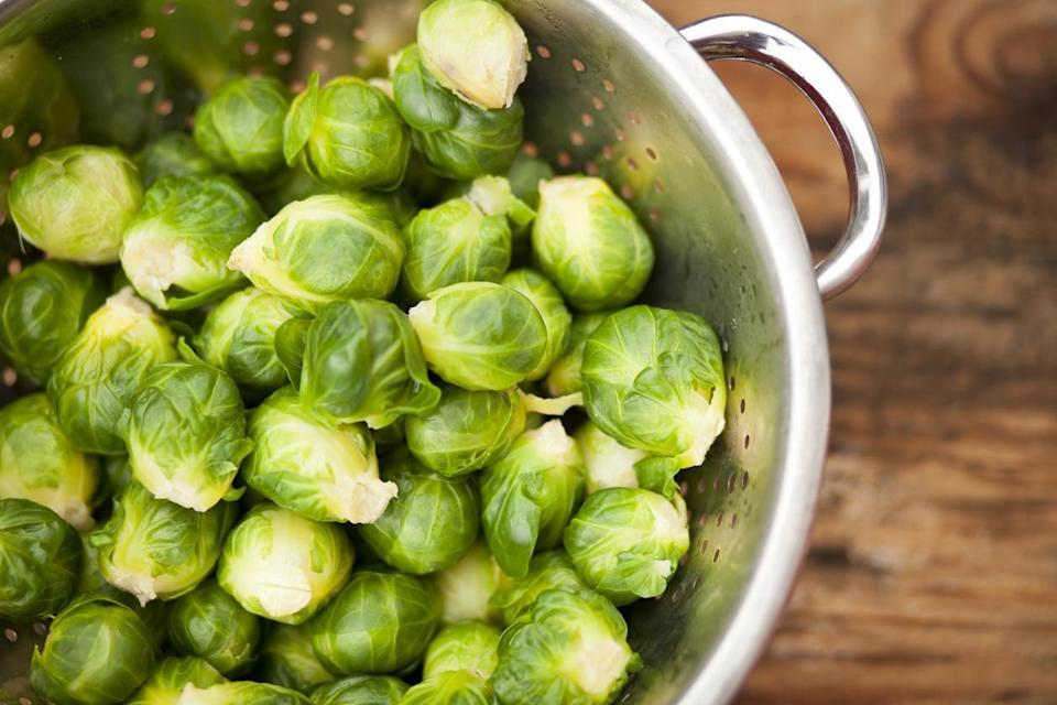 """<p>You probably have been storing Brussels sprouts by leaving them in your fridge in a bag, but there's actually a better way. Leave your Brussels sprouts in a bowl or other open container with the outer leaves left on. This will prevent the leaves from getting brown and slimy, while the outer leaves of the sprouts protect the inner layers from going bad. Then, when you <a href=""""https://www.thedailymeal.com/best-way-cook-brussels-sprouts?referrer=yahoo&category=beauty_food&include_utm=1&utm_medium=referral&utm_source=yahoo&utm_campaign=feed"""" rel=""""nofollow noopener"""" target=""""_blank"""" data-ylk=""""slk:cook your perfect batch of Brussels sprouts"""" class=""""link rapid-noclick-resp"""">cook your perfect batch of Brussels sprouts</a>, your leaves will be crisp and fresh.</p>"""