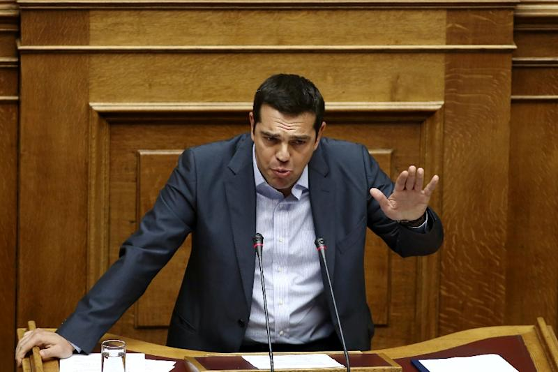Greek Prime Minister Alexis Tsipras suffered an unprecedented setback in Greek parliament on Friday (AFP Photo/Panayiotis Tzamaros )