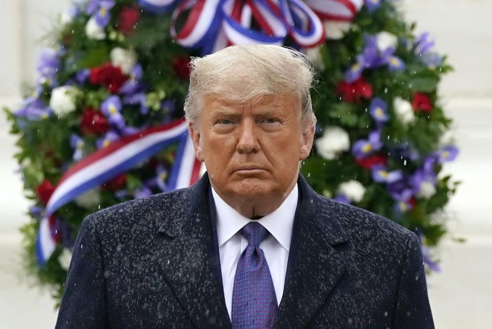"""<span class=""""caption"""">U.S. President Donald Trump participates in a Veterans Day wreath-laying ceremony at the Tomb of the Unknown Soldier at Arlington National Cemetery in Arlington, Va., on Nov. 11, 2020. </span> <span class=""""attribution""""><span class=""""source"""">(AP Photo/Patrick Semansky)</span></span>"""