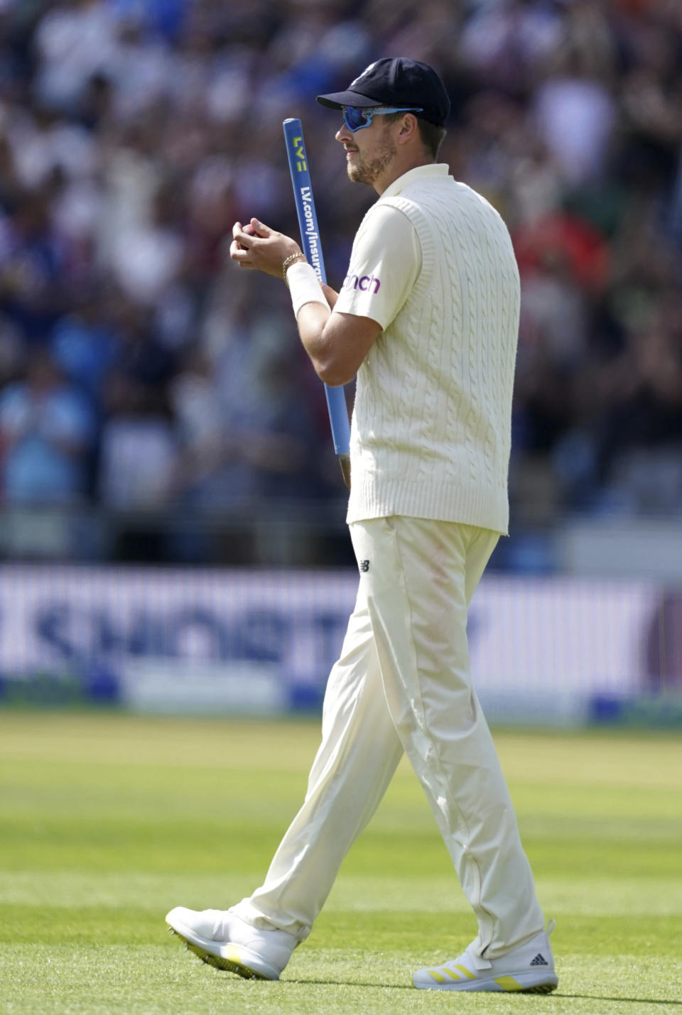 England's Ollie Robinson holds a stump as he walks off the field after their win on the fourth day of third test cricket match between England and India, at Headingley cricket ground in Leeds, England, Saturday, Aug. 28, 2021. (AP Photo/Jon Super)