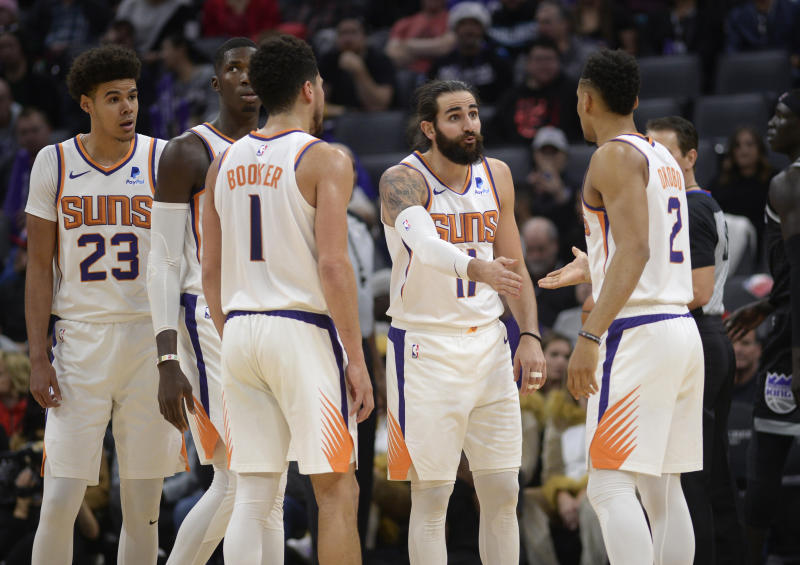 Booker scores 32 to help Suns hold off Kings and end skid
