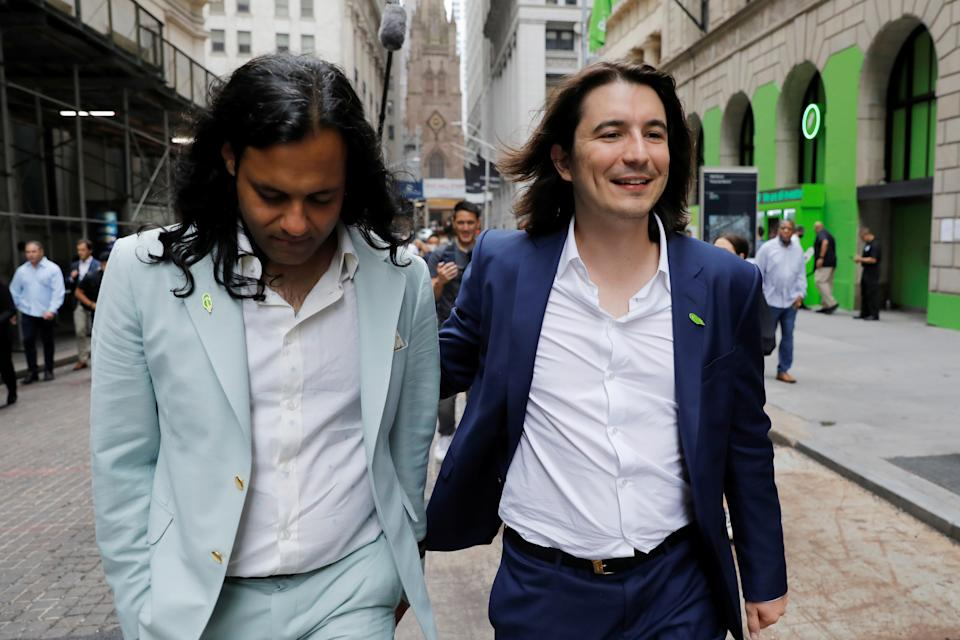 Robinhood Markets, Inc. co-founder Baiju Bhatt and CEO and co-founder Vlad Tenev walk on Wall Street after the company's IPO in New York City, U.S., July 29, 2021.  REUTERS/Andrew Kelly