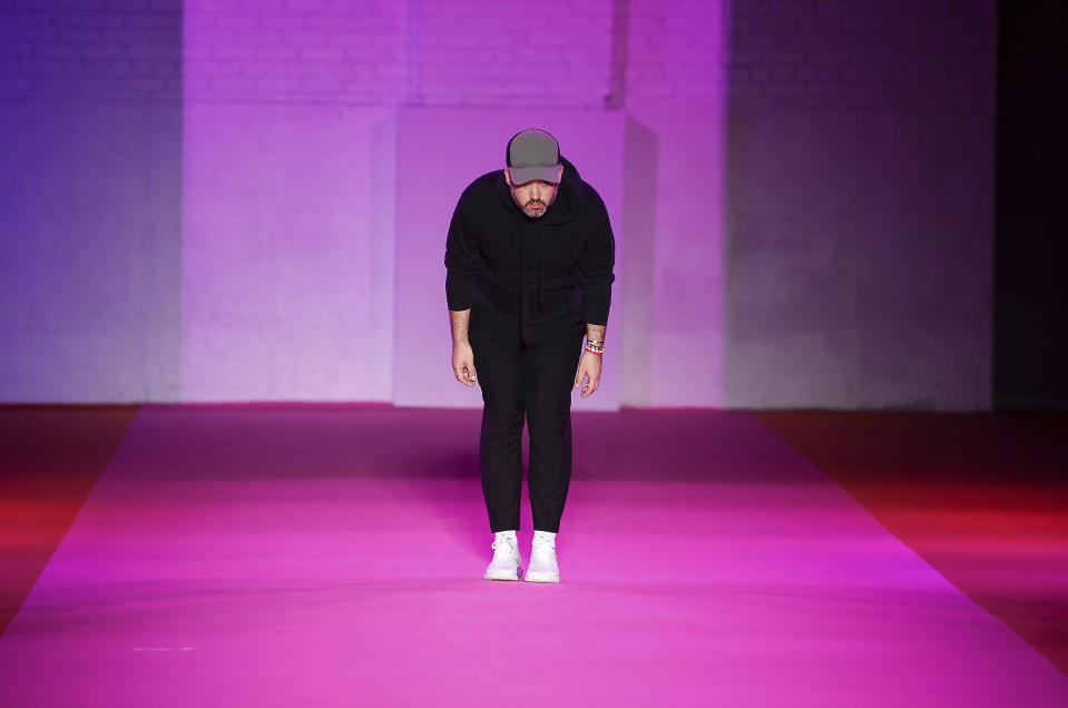 Fashion designer Brandon Maxwell takes a bow after his spring/summer 2022 fashion show in the Brooklyn borough of New York during Fashion Week on Friday, Sept. 10, 2021. (Photo by Evan Agostini/Invision/AP)