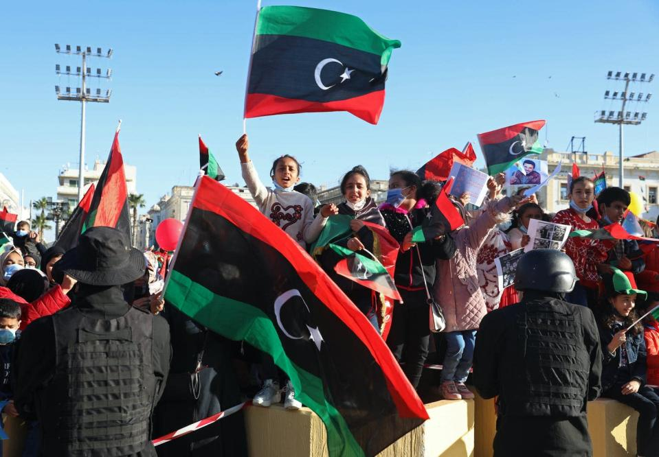 """<span class=""""caption"""">Under tight security, Libyans mark the 10th anniversary of their 2011 uprising that led to the overthrow and killing of longtime ruler Moammar Gadhafi in Martyrs Square, Tripoli, Libya. </span> <span class=""""attribution""""><span class=""""source"""">(AP Photo/Hazem Ahmed)</span></span>"""