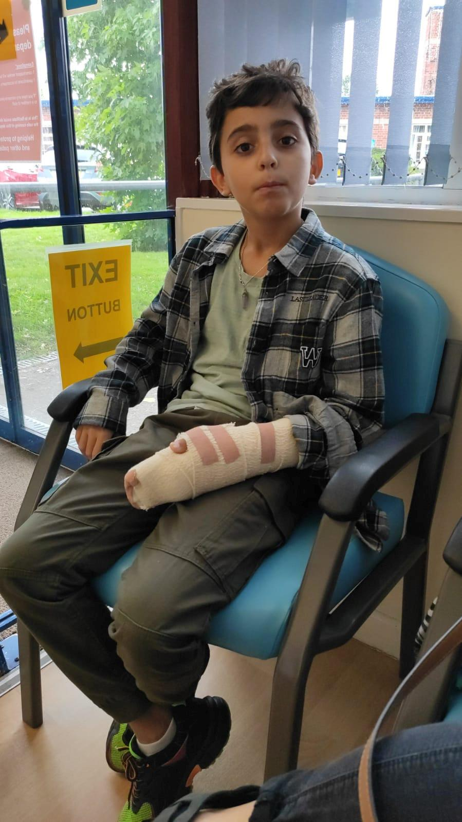 Oliver, 9, will need intensive physiotherapy to regain use of his hand (SWNS)
