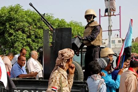 FILE PHOTO: Members of UAE-backed southern Yemeni separatists forces are seen together with their supporters as they march during a rally in southern port city in Aden