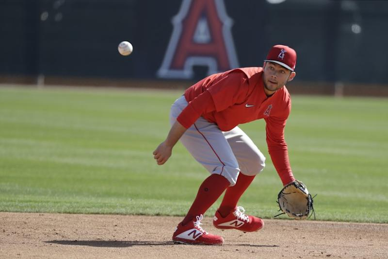Los Angeles Angels' David Fletcher fields a ground ball during spring training baseball practice, Monday, Feb. 17, 2020, in Tempe, Ariz. (AP Photo/Darron Cummings)