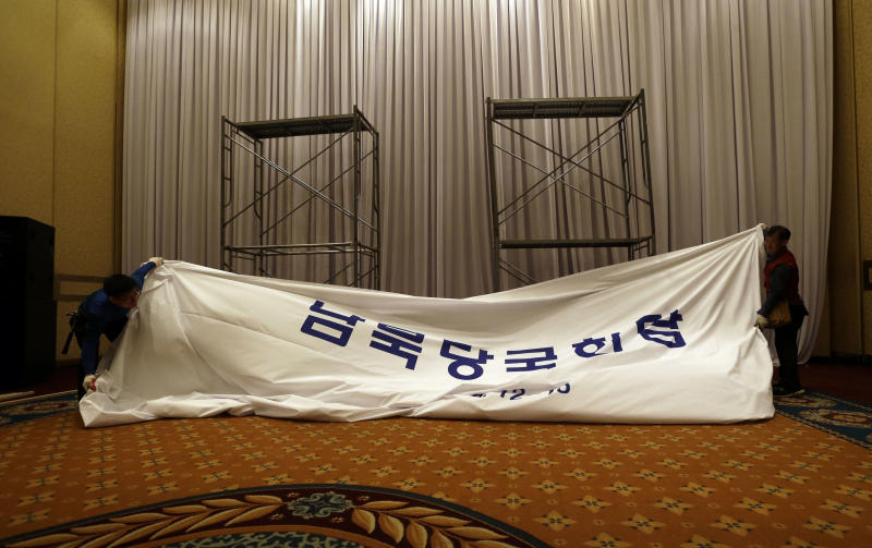 "South Korean workers dismantle a signboard at the venue for the Koreas' first high-level meeting at Grand Hilton Hotel in Seoul, South Korea, Wednesday, June 12, 2013. The Koreas' first high-level talks in years were scrapped a day before they were to begin Wednesday because the sides didn't agree on the delegation leaders, South Korea said. The cancellation deflated tentative hopes that the rivals would improve ties following years of rising hostility. The letters read "" South and North Government Level Talks."" (AP Photo/Lee Jin-man)"