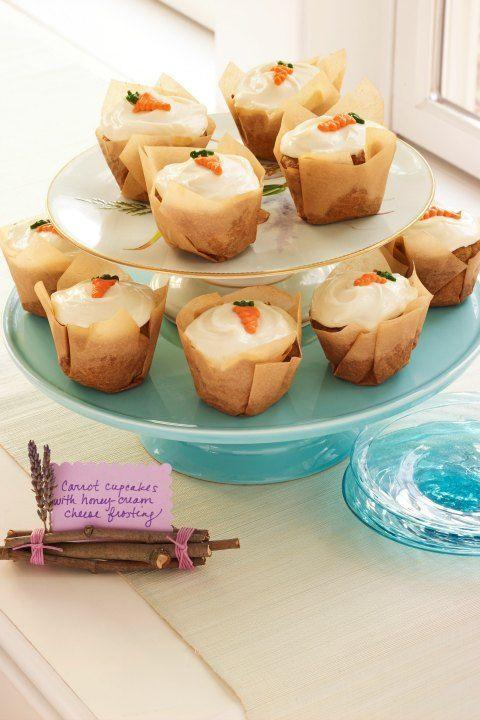 """<p>These cute cupcakes are the perfect ending to a springtime dinner.</p><p><strong><a href=""""https://www.womansday.com/food-recipes/food-drinks/recipes/a49988/carrot-cupcakes-with-honey-cream-cheese/"""" rel=""""nofollow noopener"""" target=""""_blank"""" data-ylk=""""slk:Get the recipe."""" class=""""link rapid-noclick-resp"""">Get the recipe.</a></strong></p>"""