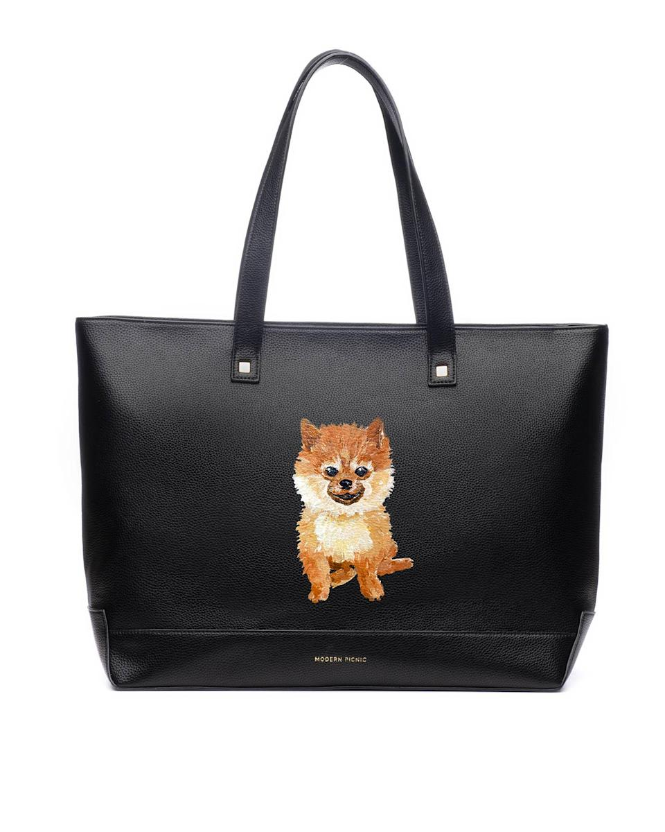 "<p>Dog parents can keep their pets close, even while their out of the house, with this custom purse. </p> <p><strong>Buy it!</strong> The Pet Portrait Tote, $260.00; <a href=""https://modernpicnic.com/products/pet-portrait-tote"" rel=""sponsored noopener"" target=""_blank"" data-ylk=""slk:ModernPicnic.com"" class=""link rapid-noclick-resp"">ModernPicnic.com</a></p>"