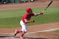 St. Louis Cardinals' Tyler O'Neill watches after hitting a three-run home run during the seventh inning of a spring training baseball game against the Houston Astros, Sunday, March 7, 2021, in Jupiter, Fla. (AP Photo/Lynne Sladky)