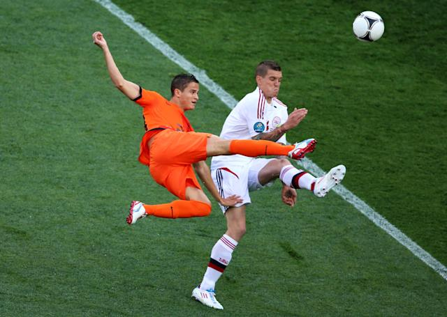 KHARKOV, UKRAINE - JUNE 09: Ibrahim Afellay of Netherlands and Daniel Agger of Denmark compete for the ball during the UEFA EURO 2012 group B match between Netherlands and Denmark at Metalist Stadium on June 9, 2012 in Kharkov, Ukraine. (Photo by Julian Finney/Getty Images)
