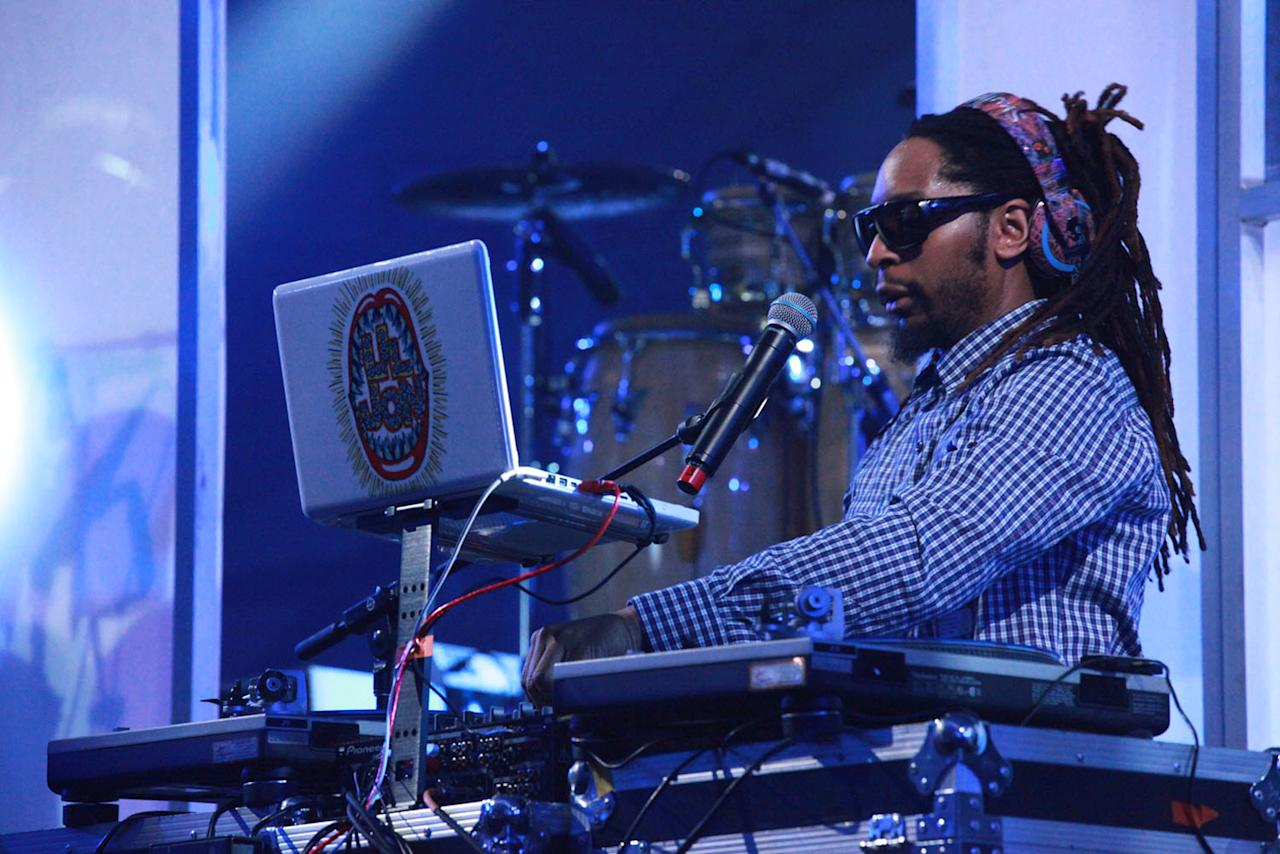 Lil Jon spins a DJ set before Pitbull and 50 Cent take the stage at the Bud Light Hotel concert in Indianapolis.