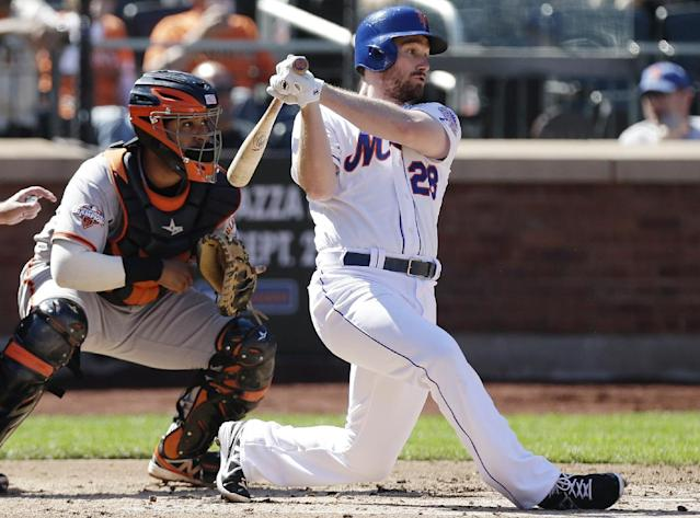 San Francisco Giants catcher Hector Sanchez watches as New York Mets' Daniel Murphy (28) follows through with an RBI single in the fourth inning of a baseball game Thursday, Sept. 19, 2013, in New York. (AP Photo/Frank Franklin II)