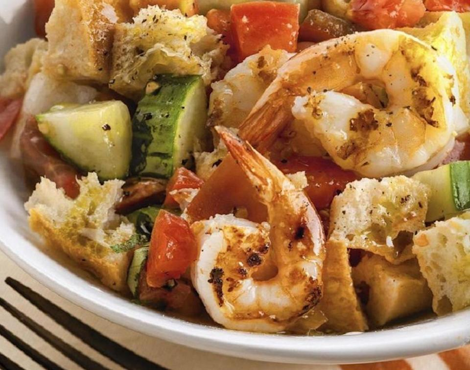 """<p>If you're <a href=""""https://www.thedailymeal.com/cook/24-ways-turn-yesterday-s-food-scraps-tomorrow-s-dinner-slideshow?referrer=yahoo&category=beauty_food&include_utm=1&utm_medium=referral&utm_source=yahoo&utm_campaign=feed"""" rel=""""nofollow noopener"""" target=""""_blank"""" data-ylk=""""slk:trying to reduce food waste"""" class=""""link rapid-noclick-resp"""">trying to reduce food waste</a>, skip making your own bread crumbs and just put day old bread cubes into your salad as is. That's the key to making panzanella, a chopped salad that originated in Italy, which is typically made with tomatoes, cucumber and oil and vinegar. It's the perfect way to <a href=""""https://www.thedailymeal.com/cook/recipes-finish-bread-loaf?referrer=yahoo&category=beauty_food&include_utm=1&utm_medium=referral&utm_source=yahoo&utm_campaign=feed"""" rel=""""nofollow noopener"""" target=""""_blank"""" data-ylk=""""slk:finish off a loaf of bread"""" class=""""link rapid-noclick-resp"""">finish off a loaf of bread</a>.</p> <p><a href=""""https://www.thedailymeal.com/recipes/panzanella-grilled-shrimp?referrer=yahoo&category=beauty_food&include_utm=1&utm_medium=referral&utm_source=yahoo&utm_campaign=feed"""" rel=""""nofollow noopener"""" target=""""_blank"""" data-ylk=""""slk:For the Panzanella With Grilled Shrimp recipe, click here."""" class=""""link rapid-noclick-resp"""">For the Panzanella With Grilled Shrimp recipe, click here.</a></p>"""