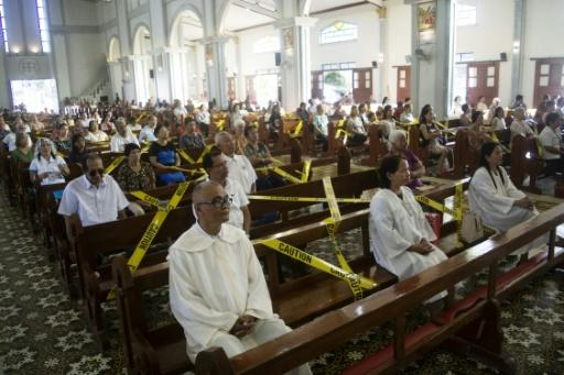 A Catholic church in the central Philippines held its Sunday service with worshippers separated by barricade tape